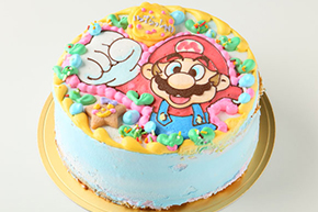 キャラクターを描いたカラフルなケーキ