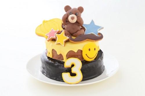 スマイルイエロードリップ2段ケーキ 人形付き 上段4号 下段5号